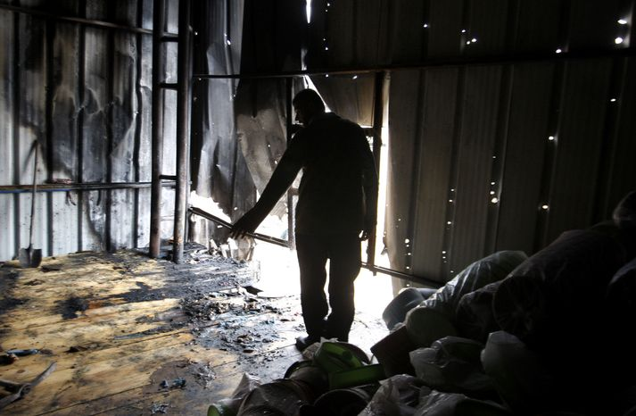 A Palestinian stands in a factory hit by an Israeli tank shell in Beit Hanoun, northern Gaza Strip, on Nov. 11, 2012. (Associated Press)