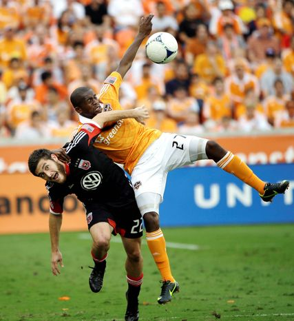 D.C. United's Chris Korb (22) battles Houston Dynamo's Boniek Garcia (27) for the ball during the first half of an MLS Eastern Conference Championship soccer game, Sunday, Nov. 11, 2012, in Houston. (AP Photo/David J. Phillip)
