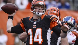 Cincinnati Bengals quarterback Andy Dalton (14) passes against the New York Giants in the first half of an NFL football game, Sunday, Nov. 11, 2012, in Cincinnati. (AP Photo/Michael Keating)