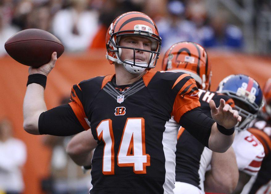 Cincinnati Bengals quarterback Andy Dalton (14) passes against the New York Giants in the first half of an NFL football game, Sunday, Nov. 11, 2012, in Cincinnati. (AP Photo/Michael Keating)