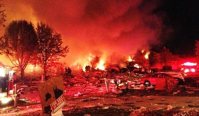 A loud explosion Nov. 10, 2012, in the Richmond Hill subdivision in Indianapolis killed two people and damaged more than a dozen homes, authorities said. (Associated Press/The Indianapolis Star)