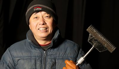 Wei Xian Chun, 52, is one of the 40 artisan ice sculptors from Harbin, China,  working on the construction of the attraction ICE! featuring DreamWorks Shrek the Halls at the Gaylord National Resort & Convention Center in National Harbor, Md. (Rod Lamkey Jr./The Washington Times)
