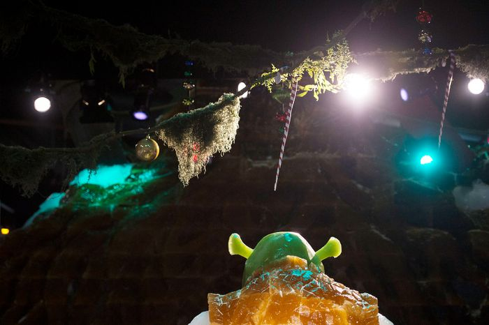 Ice sculptures from the Shrek movies are seen on the big ice slide, under colorful lights in a room temperature of nine degrees, as the artisan ice sculptors from Harbin, China, put the final touches on the attraction ICE! featuring DreamWorks Shrek the Halls at the Gaylord National Resort & Convention Center in National Harbor, Md. (Rod Lamkey Jr./The Washington Times)