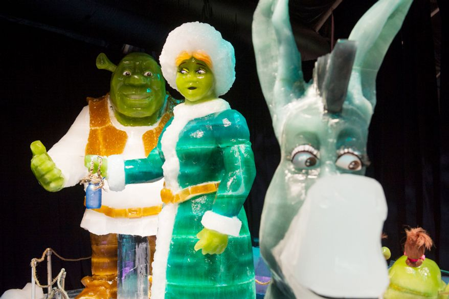 Ice sculptures from the Shrek movies are seen under colorful lights in a room temperature of nine degrees, as the artisan ice sculptors from Harbin, China, put the final touches on the attraction ICE! featuring DreamWorks Shrek the Halls at the Gaylord National Resort & Convention Center in National Harbor, Md. (Rod Lamkey Jr./The Washington Times)