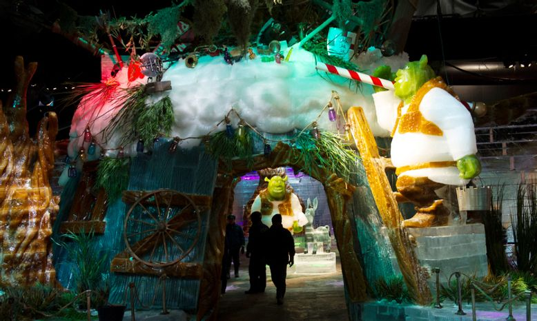 Artisan ice sculptors from Harbin, China, put the final touches on the attraction ICE! featuring DreamWorks Shrek the Halls at the Gaylord National Resort & Convention Center in National Harbor, Md.  (Rod Lamkey Jr./The Washington Times)