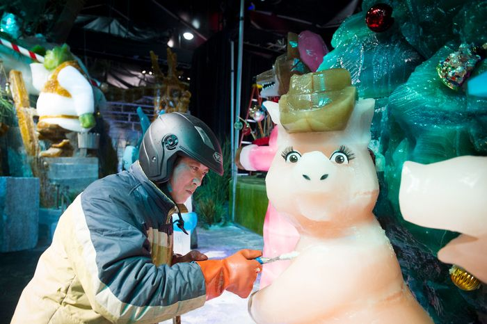 An artisan ice sculptor from Harbin, China, puts the final touches on the attraction ICE! featuring DreamWorks Shrek the Halls at the Gaylord National Resort & Convention Center in National Harbor, Md., Friday, Nov. 9, 2012.  (Rod Lamkey Jr./The Washington Times)