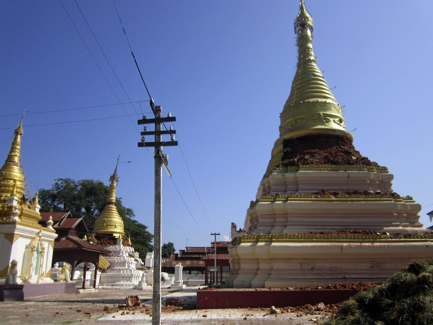 Pagodas in Kyaukmyaung, east of Shwebo, Myanmar, are seen destroyed after a strong earthquake on Nov. 11, 2012. The magnitude-6.8 quake struck northern Myanmar, collapsing a bridge and a gold mine, damaging several old Buddhist pagodas and leaving as many as 12 people feared dead. (Associated Press/Weekly Eleven News)