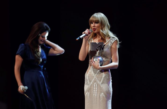 Singer Taylor Swift receives an award for the best song during the 2012 MTV European Music Awards show at the Festhalle in Frankfurt, central Germany, Sunday, Nov. 11, 2012. (AP Photo/Michael Probst)