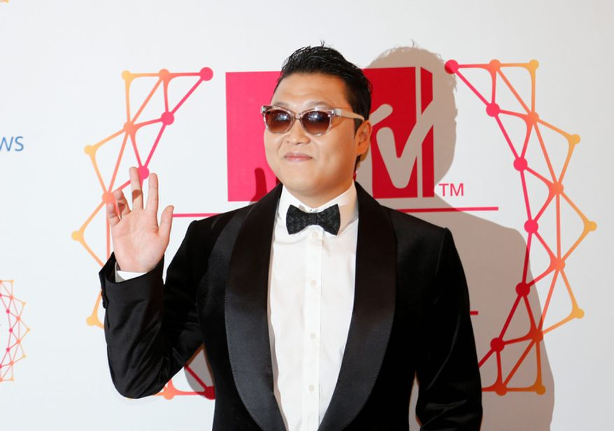 South Korean Psy arrives on the red carpet of the 2012 MTV European Music Awards show at the Festhalle in Frankfurt, central Germany, Sunday, Nov. 11, 2012. (AP Photo/Frank Augstein)