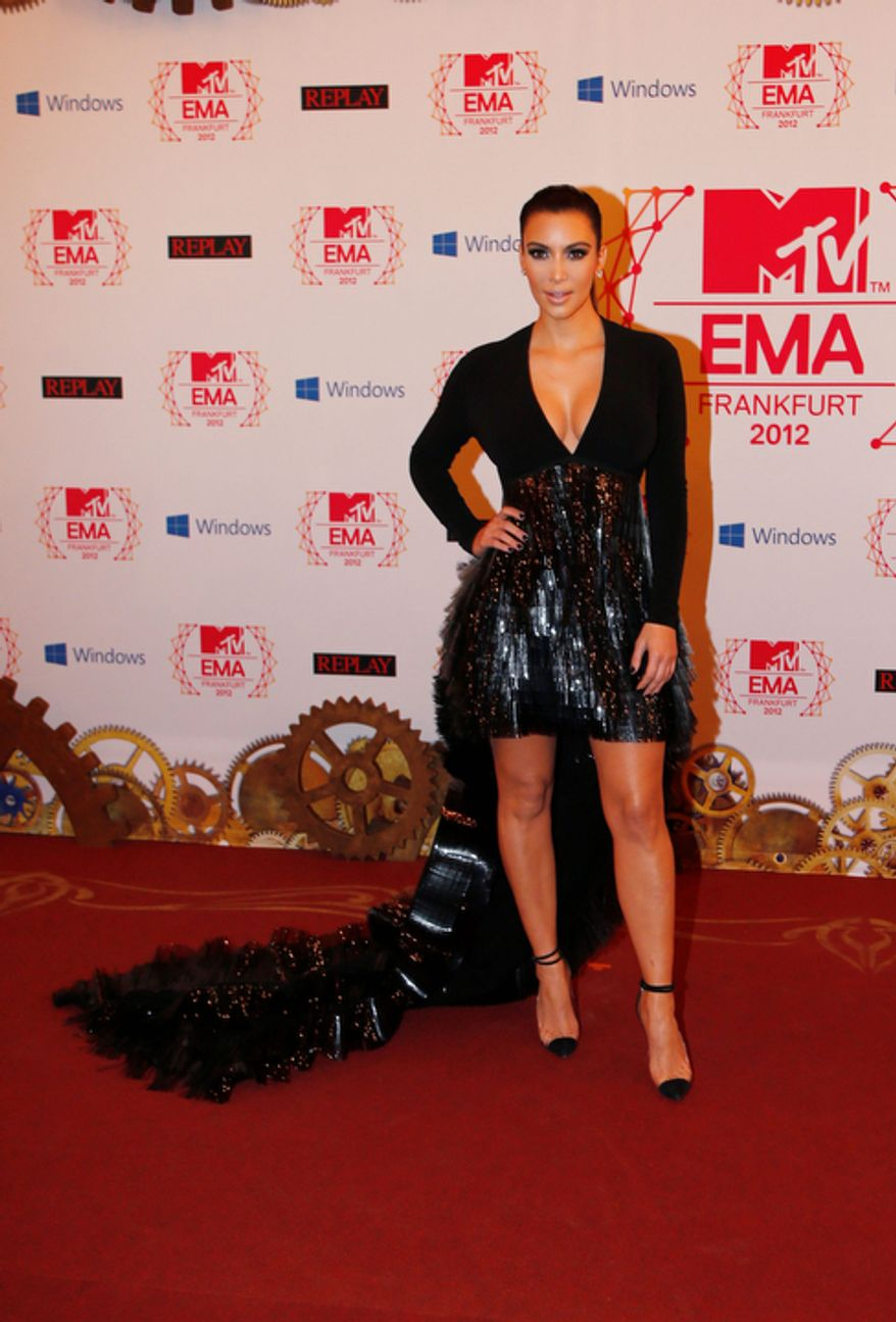Presenter Kim Kardashian arrives on the red carpet of the 2012 MTV European Music Awards show at the Festhalle in Frankfurt, central Germany, Sunday, Nov. 11, 2012. (AP Photo/Frank Augstein)