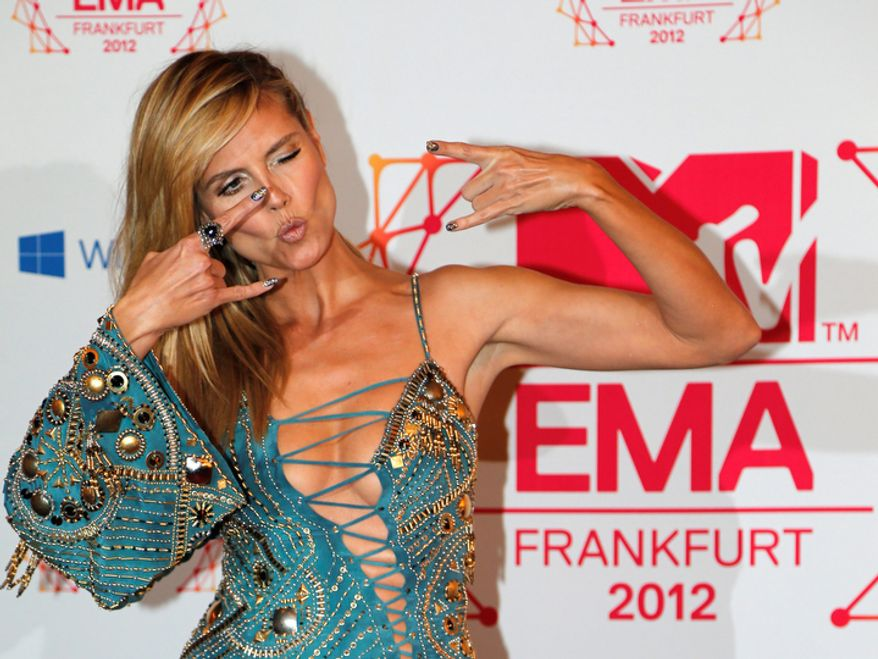 German TV host Heidi Klum arrives on the red carpet of the 2012 MTV European Music Awards show at the Festhalle in Frankfurt, central Germany, Sunday, Nov. 11, 2012. (AP Photo/Frank Augstein)