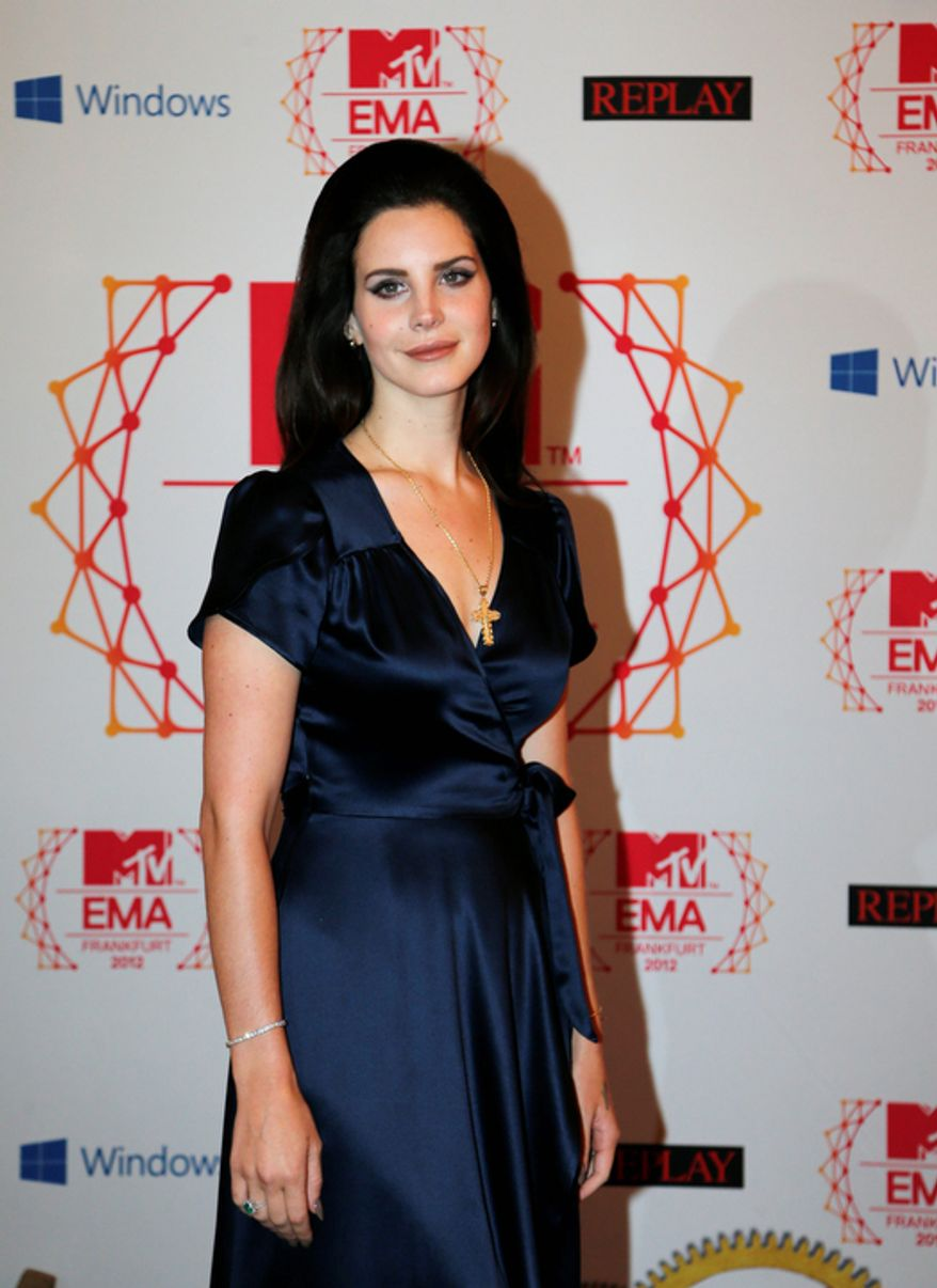 Best Alternative nominee Lana Del Ray arrives on the red carpet of the 2012 MTV European Music Awards show at the Festhalle in Frankfurt, central Germany, Sunday, Nov. 11, 2012. (AP Photo/Frank Augstein)