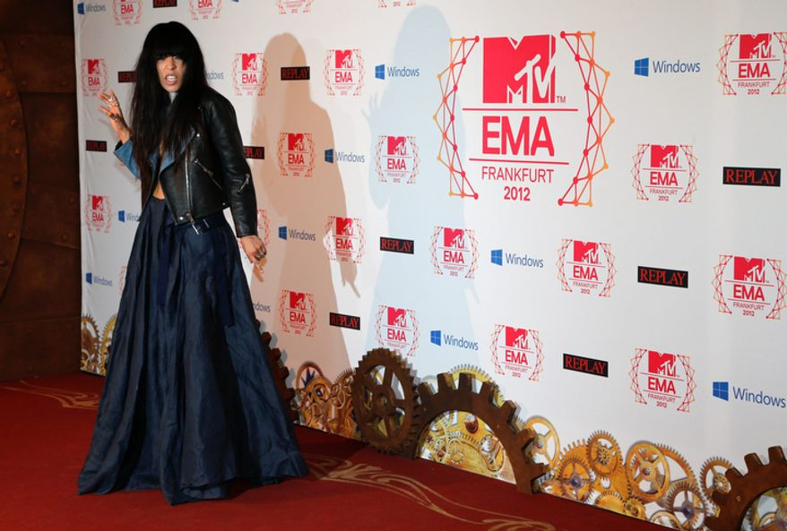 Swedish singer-songwriter Loreen arrives on the red carpet of the 2012 MTV European Music Awards show at the Festhalle in Frankfurt, central Germany, Sunday, Nov. 11, 2012. (AP Photo/Frank Augstein)