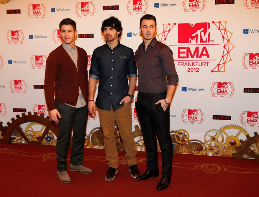 The Jonas brothers arrive on the red carpet of the 2012 MTV European Music Awards show at the Festhalle in Frankfurt, central Germany, Sunday, Nov. 11, 2012. (AP Photo/Frank Augstein)