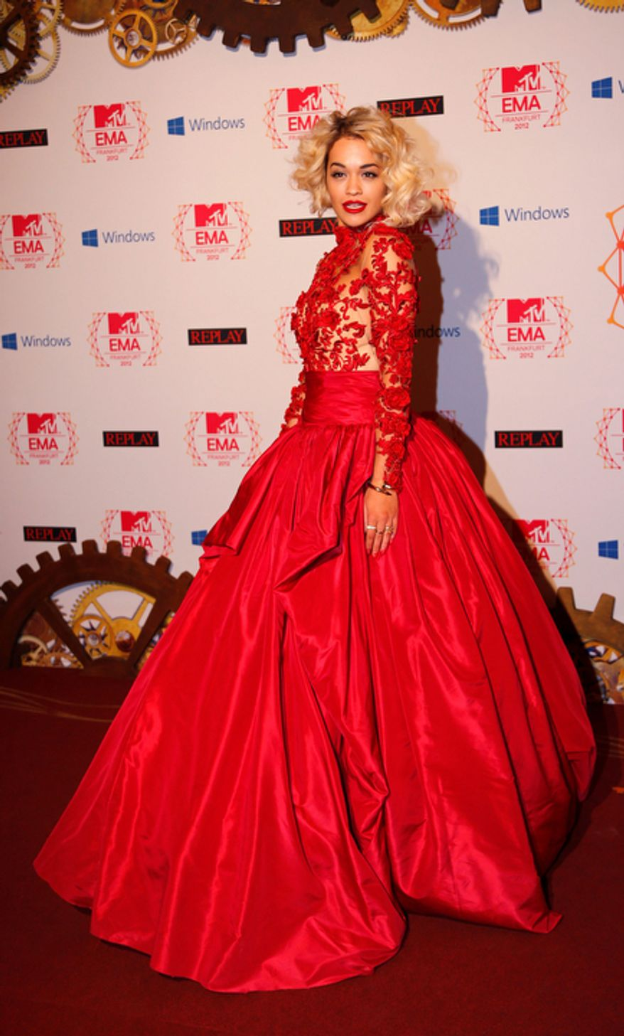 British singer Rita Ora arrives on the red carpet of the 2012 MTV European Music Awards show at the Festhalle in Frankfurt, central Germany, Sunday, Nov. 11, 2012. (AP Photo/Frank Augstein)