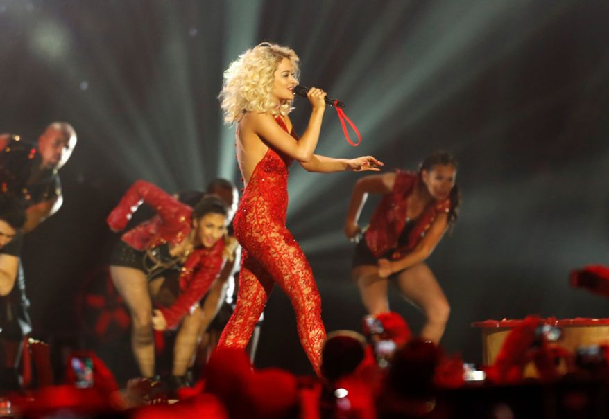 British singer Rita Ora performs during the 2012 MTV European Music Awards show at the Festhalle in Frankfurt, central Germany, Sunday, Nov. 11, 2012. (AP Photo/Michael Probst)