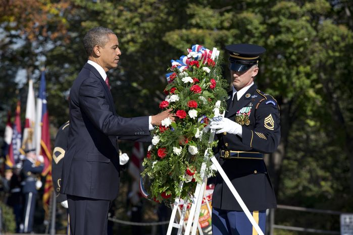 President Obama presents a wreath at the Tomb of the Unknowns at Arlington National Cemetery in Arlington, Va., during a Veterans Day ceremony on Nov. 11, 2012. (Associated Press)