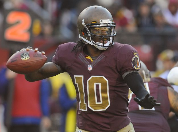 Washington Redskins quarterback Robert Griffin III (10) looks to pass during the second half of an NFL football game against the Carolina Panthers Sunday, Nov. 4, 2012, in Landover, Md. (AP Photo/Richard Lipski)