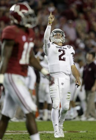 Texas A&M quarterback Johnny Manziel (2) reacts during the second half of his team's 29-24 win against No. 1 Alabama in Tuscaloosa, Ala., on Nov. 10, 2012. At left is Alabama defensive back John Fulton. (Associated Press)