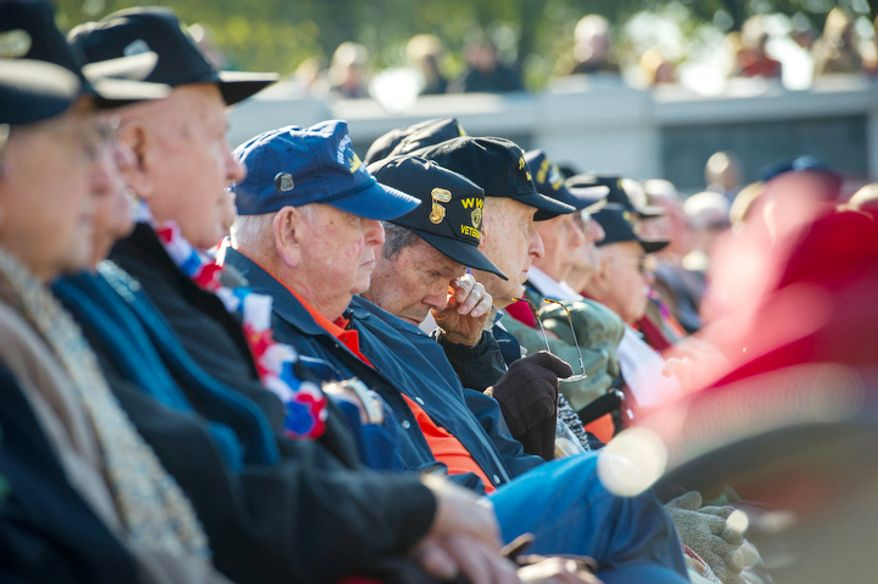 A World War II veteran wipes his eyes during speeches at the Veterans Day at the National World War II Memorial event in Washington, D.C., Sunday, Nov. 11, 2012. (Rod Lamkey Jr./The Washington Times)