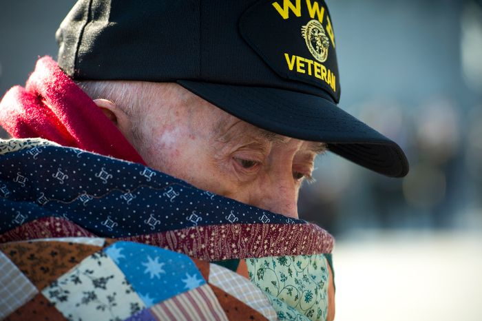 US Navy Petty Officer 3rd Class and Seabee (retired) Leon Clifton of Mt. Zion, Ill., is bundled up against the morning chill as he attends the Veterans Day at the National World War II Memorial event in Washington, D.C., Sunday, Nov. 11, 2012. (Rod Lamkey Jr./The Washington Times)