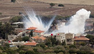 Smoke rises after shells fired by the Syrian army explode in the Syrian village of Bariqa, Monday, Nov. 12, 2012.  (AP Photo/Ariel Schalit)