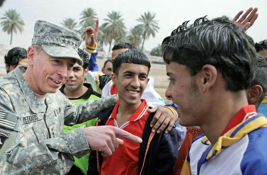 2008: The four-star general visits young soccer players in Baghdad. A central component of his plan was to win over the Iraqi population. (Associated Press)