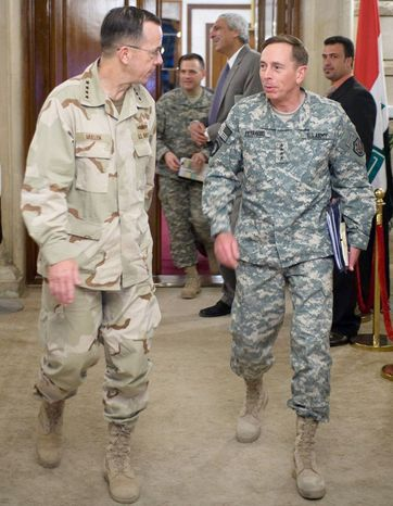 Navy Adm. Mike Mullen, chairman of the Joint Chiefs of Staff, and Mr. Petraeus leave a meeting with Iraqi Prime Minister Nouri al-Maliki in Baghdad during a six-day tour in 2008. (Associated Press)
