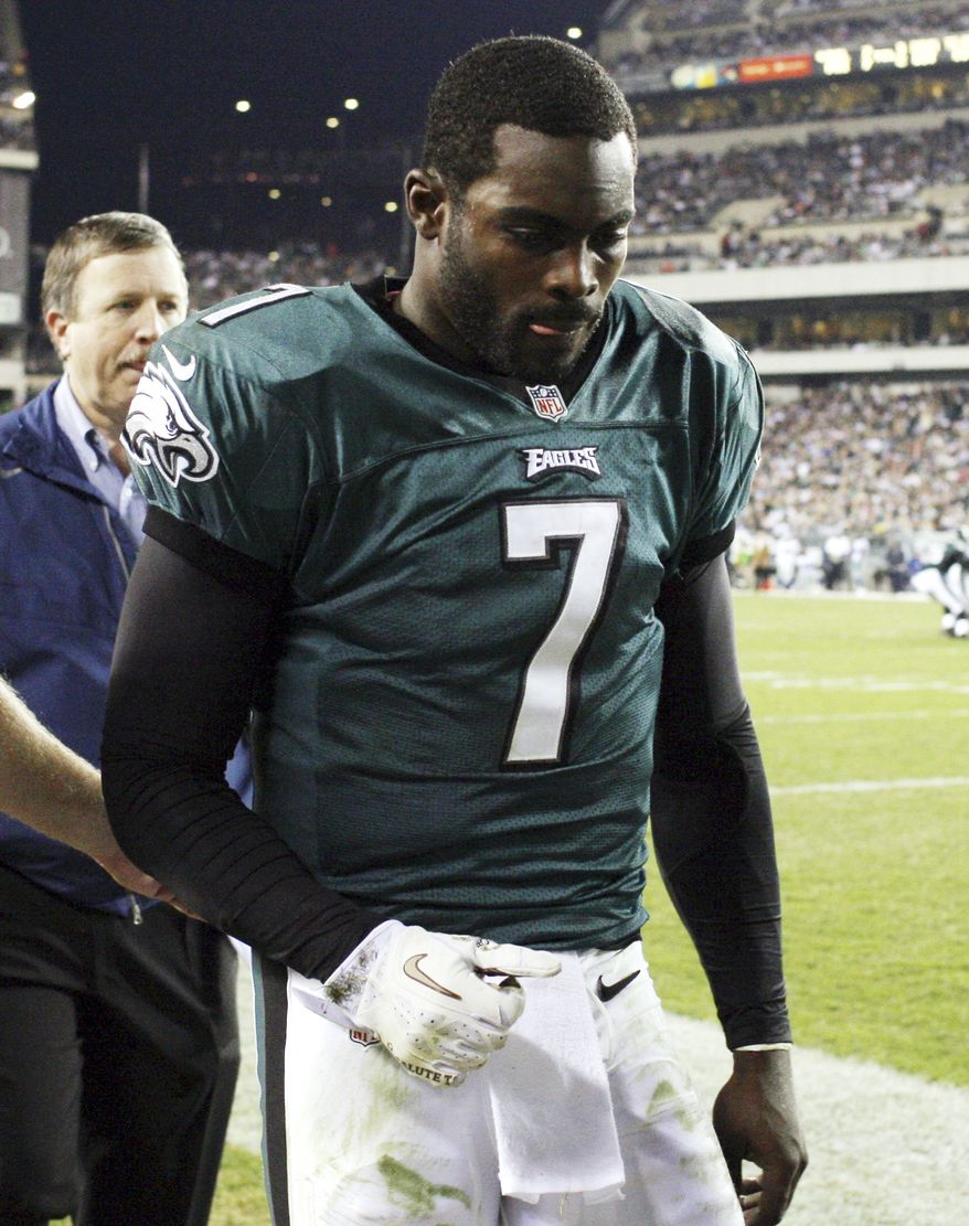 Philadelphia Eagles quarterback Michael Vick leaves the field after suffering a concussion during the second quarter of an NFL football game against the Dallas Cowboys, Sunday, Nov. 11, 2012, in Philadelphia. (AP Photo/Philadelphia Daily News, Yong Kim)  THE EVENING BULLETIN OUT, TV OUT; MAGS OUT; NO SALES