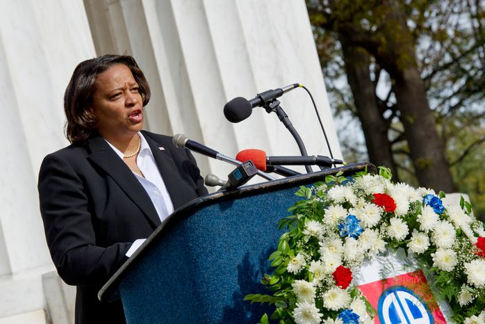 """Tomi Rucker, a Washington, D.C. Navy mom, says she was """"saddened"""" when the D.C. flag was not a part of her son's boot camp graduation, particularly because the flags of the other recruits' states were. She came to the D.C. World War I Memorial on Monday, Nov. 12, 2012 to talk about the inconsistent flying of the D.C. flag at military graduations. (Barbara L. Salisbury/The Washington Times)"""