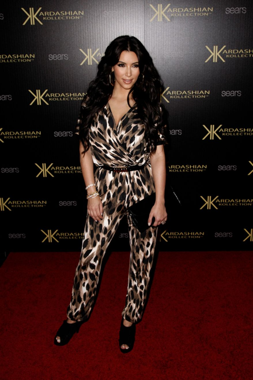 Kim Kardashian arrives at the Kardashian Kollection launch party in Los Angeles, Wednesday, Aug. 17, 2011. The Kardashian Kollection designed by the Kardashian sisters is available at Sears. (AP Photo/Matt Sayles)