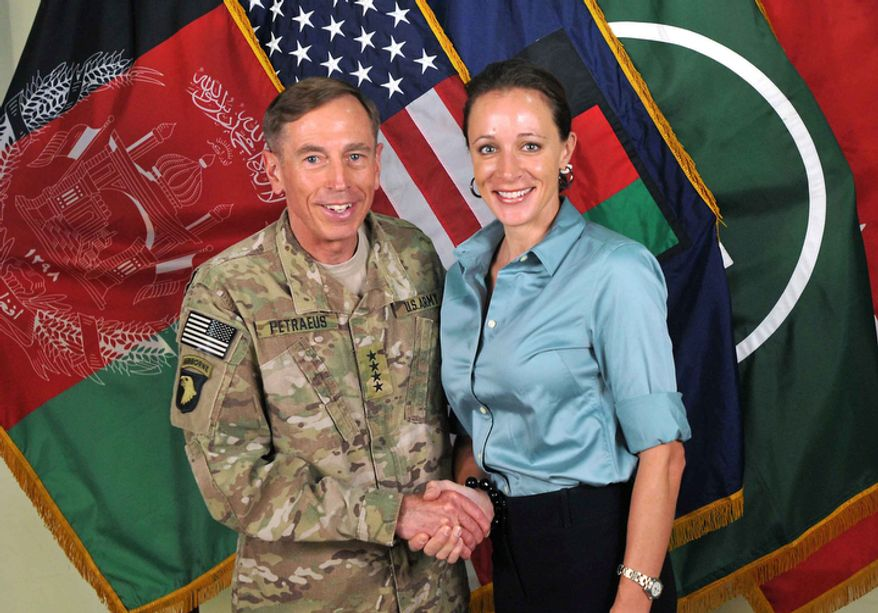 "U.S. Army Gen. David H. Petraeus, then-commander of the International Security Assistance Force and U.S. Forces-Afghanistan, shakes hands with Paula Broadwell, co-author of  ""All In: The Education of General David Petraeus,"" in a July 13, 2011, photo from the ISAF's Flickr website. (Associated Press/International Security Assistance Force) ** FILE **"