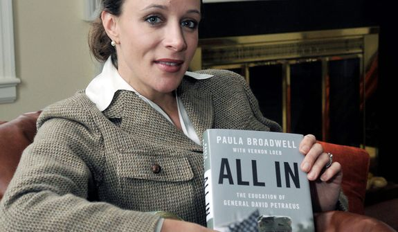 "**FILE** Paula Broadwell, author of the David Petraeus biography ""All In,"" poses for photos in Charlotte, N.C. (Associated Press/The Charlotte Observer, T. Ortega Gaines)"