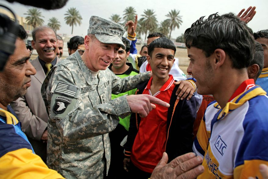 **FILE** Gen. David Petraeus (center left), the top U.S. commander in Iraq, talks March 1, 2008, to players during a youth soccer tournament in central Baghdad. (Associated Press)