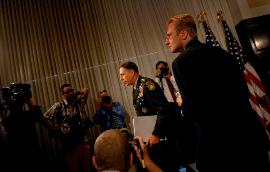 **FILE** Gen. David Petraeus makes his exit following a Sept. 12, 2007, press conference on the current conditions in Iraq, at the National Press Club in D.C. (Rod Lamkey Jr./The Washington Times)