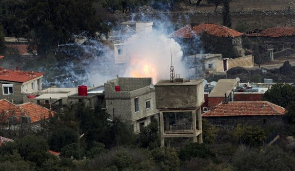 """An explosion after shells fired by the Syrian army hit the Syrian village of Bariqa on Nov. 12, 2012. The Israeli military says """"Syrian mobile artillery"""" was hit after responding to stray mortar fire from its northern neighbor. The incident marked the second straight day that Israel has responded to fire from Syria that does not appear to be aimed at Israeli targets, nonetheless Israel has promised a tough response if the fire continues. (Associated Press)"""