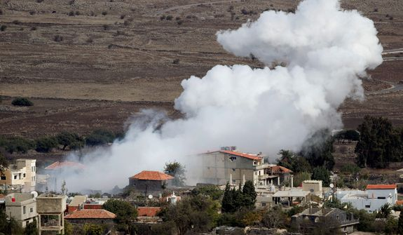 """Smoke rises after shells exploded in the Syrian village of Bariqa, near the Israeli-Syrian border, near Alonei Habashan in the Golan Heights on Nov. 12, 2012. An Israeli tank scored a """"direct hit"""" on a Syrian armored vehicle after a mortar shell landed on Israeli-held territory, the military said, in the first direct confrontation between the countries since the Syrian uprising broke out, sharpening fears that Israel could be drawn into the civil war next door. (Associated Press)"""