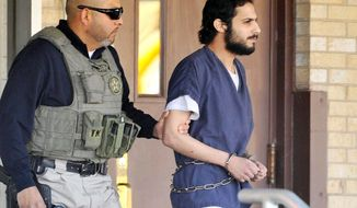 Khalid Ali-M Aldawsari, 22, is escorted from the federal courthouse in Amarillo, Texas, after being sentenced to life in prison on a federal charge of attempting to use a weapon of mass destruction in a Lubbock, Texas-based bomb-making plot. (Amarillo (Texas) Globe-News via Associated Press)