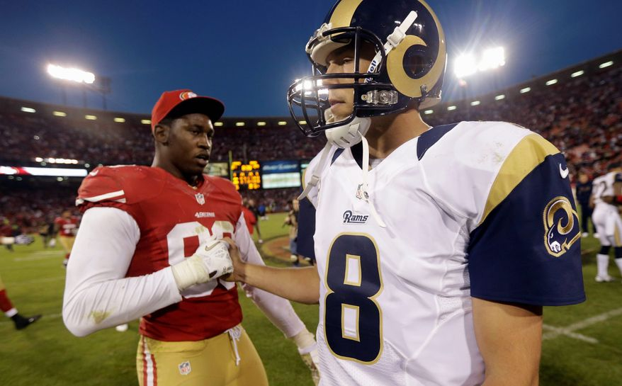 St. Louis Rams quarterback Sam Bradford, right, is greeted by San Francisco 49ers outside linebacker Aldon Smith, left, at the end of their NFL football game in San Francisco, Sunday, Nov. 11, 2012. San Francisco and St. Louis tied their game 24-24. (AP Photo/Marcio Jose Sanchez)