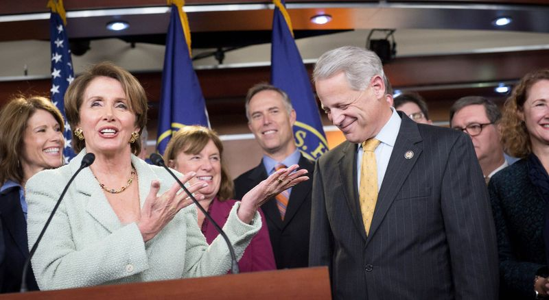 House Minority Leader Rep. Nancy Pelosi is joined by Rep. Steve Israel in introducing newly elected Democratic members of the House during a news conference Tuesday at the Capitol. The freshmen-to-be are spending a few days in orientation in preparation for their January swearing-in. (Rod Lamkey Jr./The Washington Times)