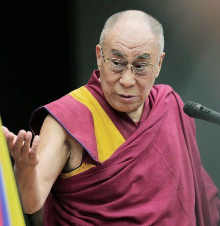 Tibetan spiritual leader the Dalai Lama delivers his speech during a seminar held by Japanese Diet members in Tokyo, Tuesday, Nov. 13, 2012. (Associated Press)