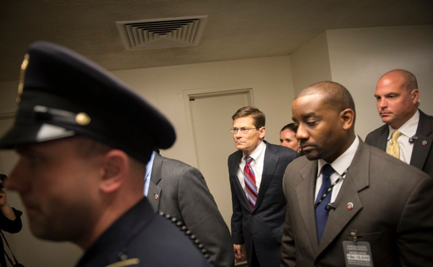 Acting CIA Director Michael Morell (in red tie) is surrounded by security as he arrives at the U.S. Capitol in Washington, D.C., Tuesday, Nov. 13, 2012, for a closed Senate Foreign Relations briefing on the attacks in Benghazi, Libya. (Rod Lamkey Jr./The Washington Times)
