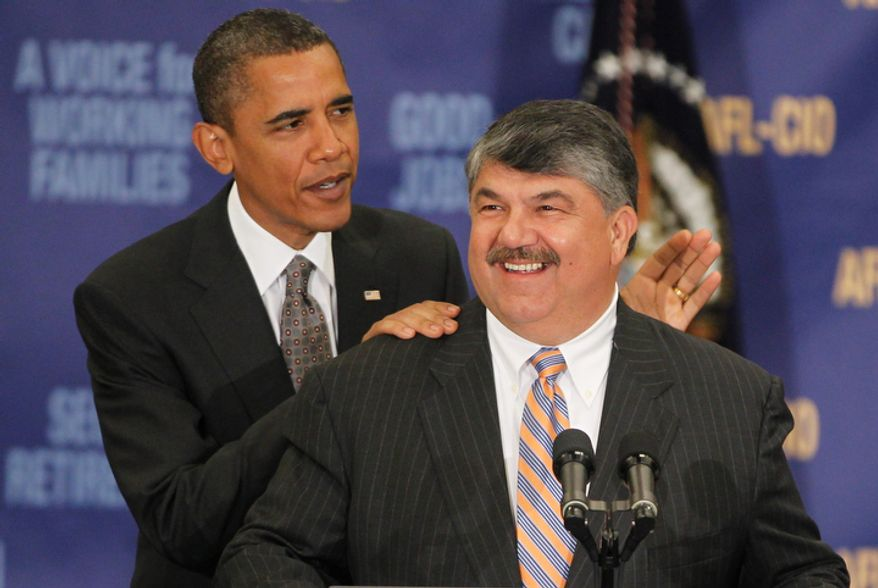 **FILE** President Obama stands Aug. 4, 2010, with AFL-CIO President Richard Trumka after he spoke about jobs and the economy at the AFL-CIO Executive Council in Washington. (Associated Press)