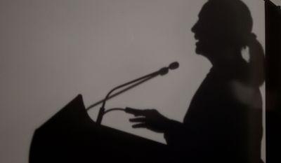 The shadow of U.S. Secretary of State Hillary Rodham Clinton is seen as she speaks Nov. 13, 2012, at University of Western Australia in Perth, Australia. (Associated Press)