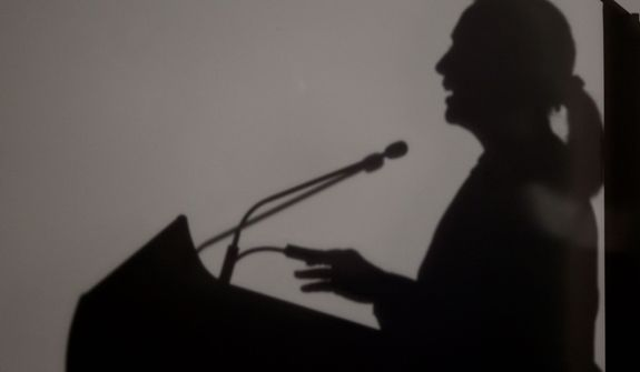 The shadow of U.S. Secretary of State Hillary Rodham Clinton is seen as she speaks Nov. 13, 2012, at University of Western Australia in Perth, Australia. (Associated Press)