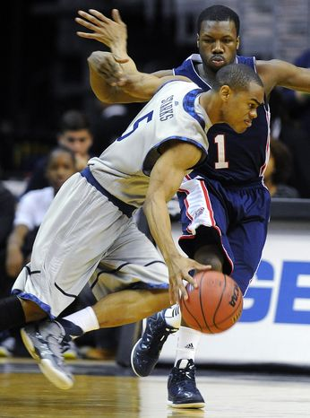 Duquesne's Derrick Colter (1) tries to defend against Georgetown's Markel Starks (5) during their NCAA college basketball game, Sunday, Nov. 11, 2012, in Washington. Georgetown won 61-55. (AP Photo/Richard Lipski)