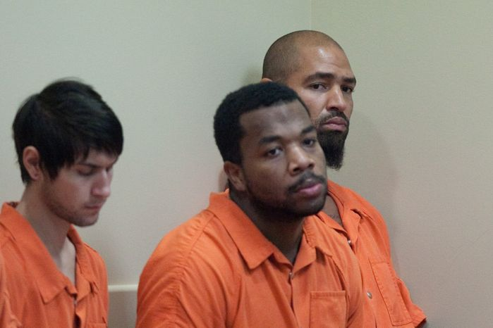 Former Seattle Seahawks player Jerramy Stevens, far right, listens during a bail hearing for Stevens at Municipal Court in Kirkland, Wash. on Tuesday, Nov. 13, 2012. Stevens appeared in court for a domestic violence probable cause hearing. He was released without conditions by the judge who didn't find probable cause to hold him. (AP Photo/seattlepi.com, Joshua Trujillo)