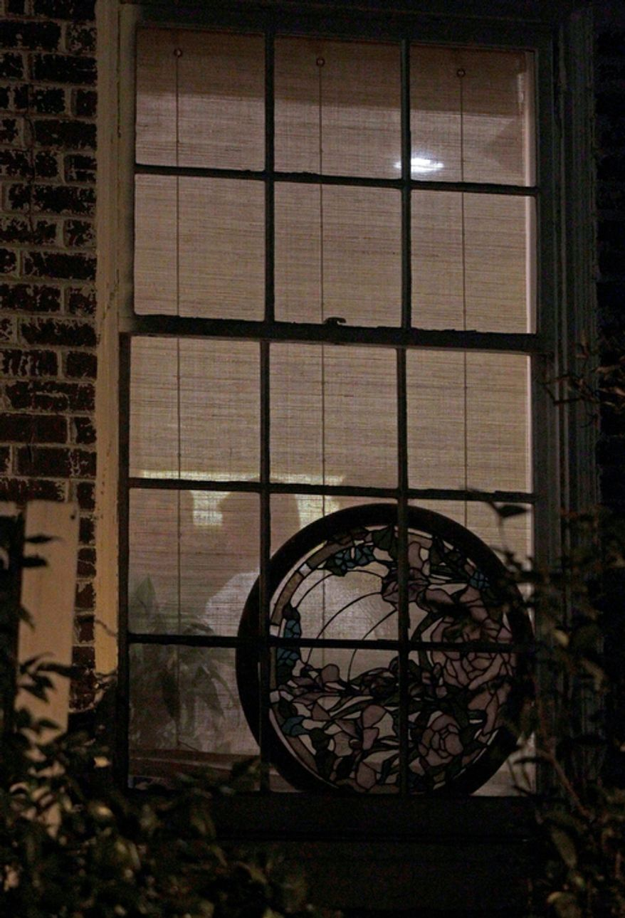 FBI agents conduct a search inside the home of Paula Broadwell, the woman whose affair with retired Gen. David Petraeus led to his resignation as CIA director, in the Dilworth neighborhood of Charlotte, N.C., on Nov. 12, 2012. (Associated Press)