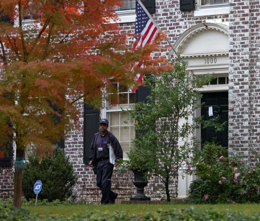 A FedEx driver leaves after trying to deliver a package to the home of Paula Broadwell, the woman whose affair with retired Gen. David Petraeus led to his resignation as CIA director, in the Dilworth neighborhood of Charlotte, N.C., on Nov. 12, 2012. FBI agents later appeared at Broadwell's home carrying the kinds of cardboard boxes often used for evidence gathering during a search. A spokeswoman for the FBI declined to say what the agents were doing there. (Associated Press/The Charlotte Observer)