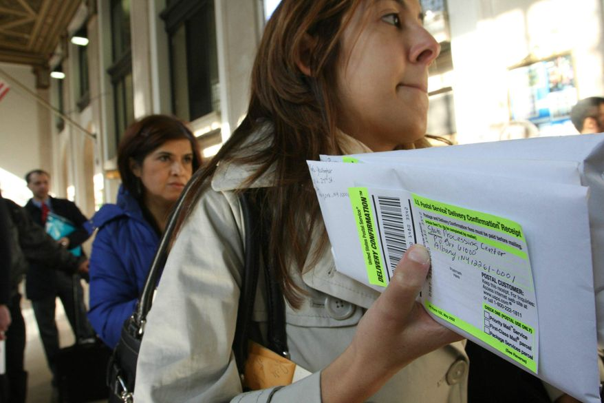 ** FILE ** Dana Pinero (foreground) of New York waits in line to mail her and her boyfriend's tax returns at the James A. Farley Main Post Office in New York on April 15, 2008. (AP Photo/Tina Fineberg)